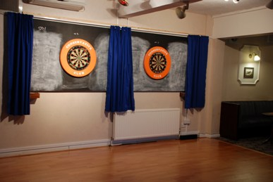 Darts area and dance floor